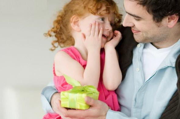 Man giving present to little girl
